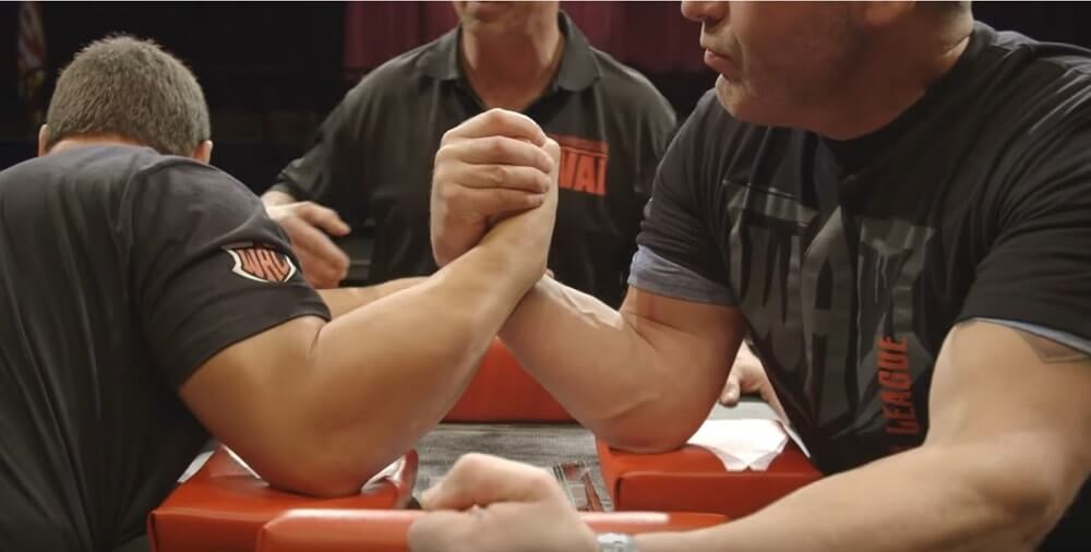 The dangerous 'break arm' position in an arm-wrestling match.